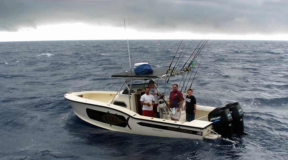 31 center console Ocean Master fishing well offshore in the Gulf of Mexico